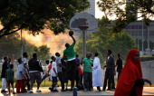 Rashad Williams an AfricanAmerican Muslim convert goes up for a basket against other boys and young men mostly Somalis during a pickup basketball...
