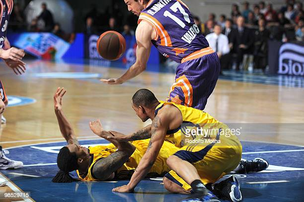 Rashad Wright #12 of Alba Berlin and Immanuel McElroy #23 competes with Rafa Martinez #17 of Power Electronics Valencia during the Alba Berlin vs...