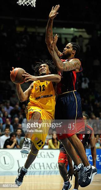 Rashad Wright #12 of Alba Berlin and Will McDonald #45 of TAU Ceramica in action during the Euroleague Basketball Game 3 match between Tau Ceramica...