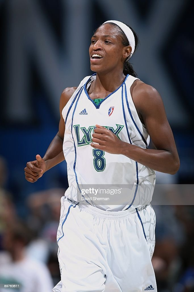 Rashanda McCants of the Minnesota Lynx runs down the court during the game against the San Antonio Silver Stars on August 9 2009 at the Target Center...