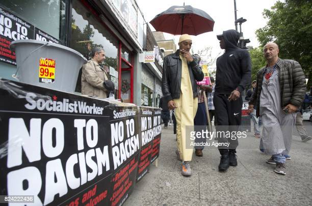 Rashan's father Patrick Charles joins protesters in a vigil for Rashan Charles outside Stoke Newington Police Station in London England on July 29 a...