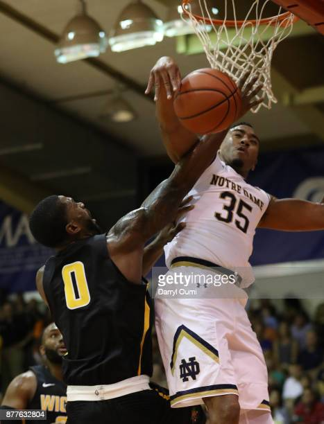Rashard Kelly of the Wichita State Shockers is fouled by Bonzie Colson of the Notre Dame Fighting Irish during the first half of their game at the...