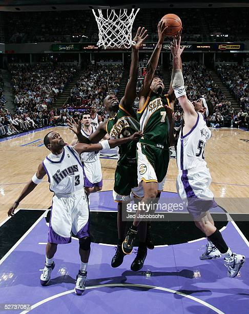 Rashard Lewis and Jerome James of the Seattle SuperSonics battle for a rebound with Brad Miller and Cuttino Mobley of the Sacramento Kings in Game...