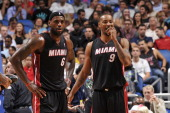 Rashard Lewis and LeBron James of the Miami Heat look on against the Orlando Magic during the game on November 20 2013 at Amway Center in Orlando...
