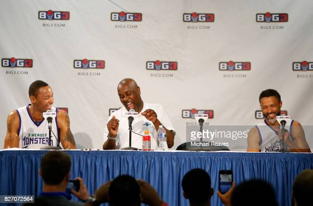 Rashard Lewis left Gary Payton and Mahmoud AbdulRauf laugh during a press conference following the game against Ball Hogs during week seven of the...