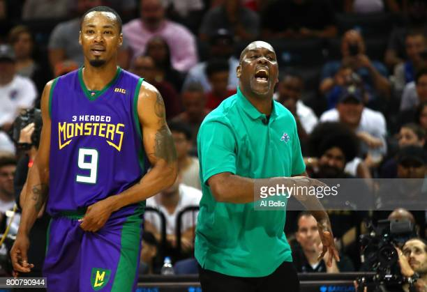 Rashard Lewis of the 3 Headed Monsters reacts with coach Gary Payton late in the game against the Ghost Ballers during week one of the BIG3 three on...