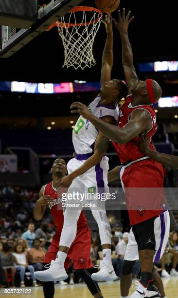 Rashard Lewis of the 3 Headed Monsters shoots on Al Harrington of Trilogy during week two of the BIG3 three on three basketball league at Spectrum...