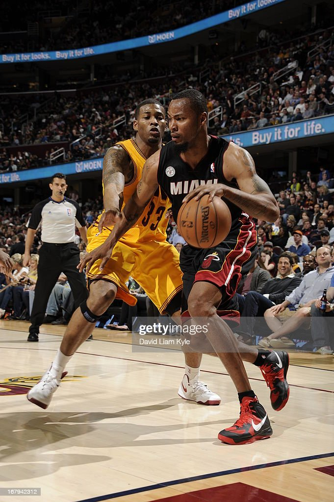 <a gi-track='captionPersonalityLinkClicked' href=/galleries/search?phrase=Rashard+Lewis&family=editorial&specificpeople=201713 ng-click='$event.stopPropagation()'>Rashard Lewis</a> #9 of the Miami Heat drives against <a gi-track='captionPersonalityLinkClicked' href=/galleries/search?phrase=Alonzo+Gee&family=editorial&specificpeople=801443 ng-click='$event.stopPropagation()'>Alonzo Gee</a> #33 of the Cleveland Cavaliers at The Quicken Loans Arena on April 15, 2013 in Cleveland, Ohio.
