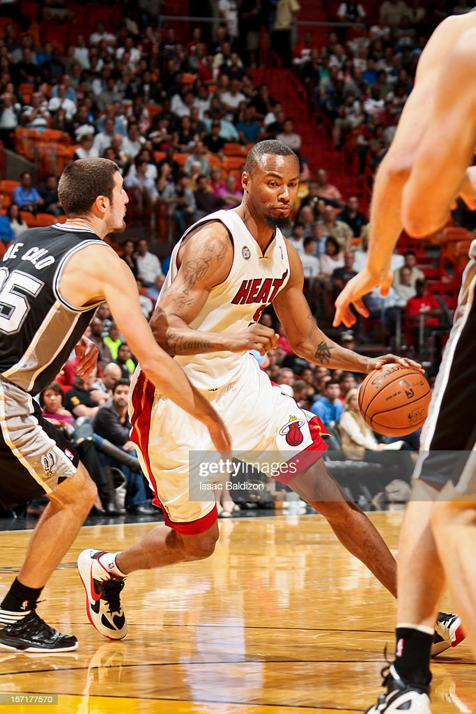 Rashard Lewis #9 of the Miami Heat drives against Nando de Colo #25 of the San Antonio Spurs on November 29, 2012 at American Airlines Arena in Miami, Florida.