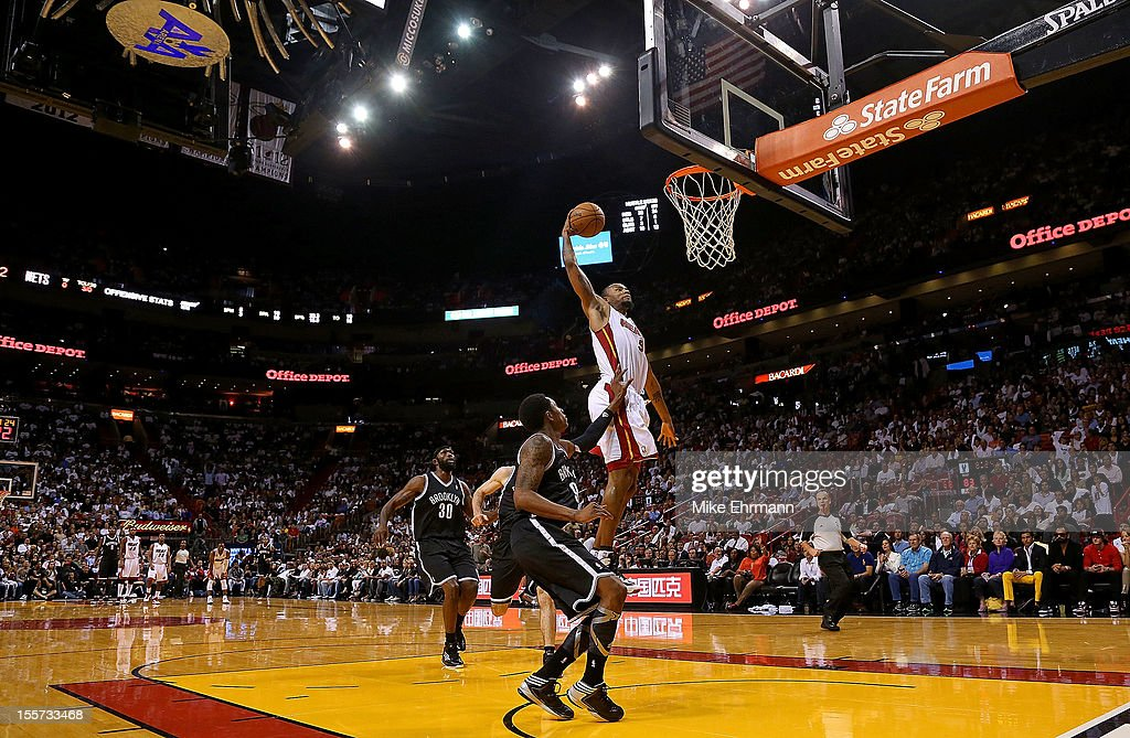 <a gi-track='captionPersonalityLinkClicked' href=/galleries/search?phrase=Rashard+Lewis&family=editorial&specificpeople=201713 ng-click='$event.stopPropagation()'>Rashard Lewis</a> #9 of the Miami Heat dunks during a game against the Brooklyn Nets at AmericanAirlines Arena on November 7, 2012 in Miami, Florida.