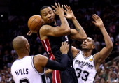 Rashard Lewis of the Miami Heat loses the ball as Boris Diaw of the San Antonio Spurs defends during Game Five of the 2014 NBA Finals at the ATT...