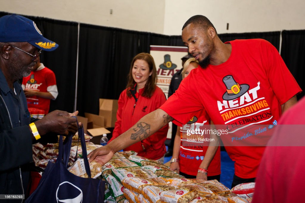Rashard Lewis #9 of the Miami Heat serves stuffing during the 2012 Heat Thanksgiving Celebration on November 20, 2012 at the Miami Rescue Mission in Miami, Florida.