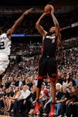 Rashard Lewis of the Miami Heat shoots against Kawhi Leonard of the San Antonio Spurs during Game Two of the 2014 NBA Finals between the Miami Heat...