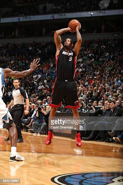 Rashard Lewis of the Miami Heat shoots the ball against the Minnesota Timberwolves during the game on December 7 2013 at Target Center in Minneapolis...
