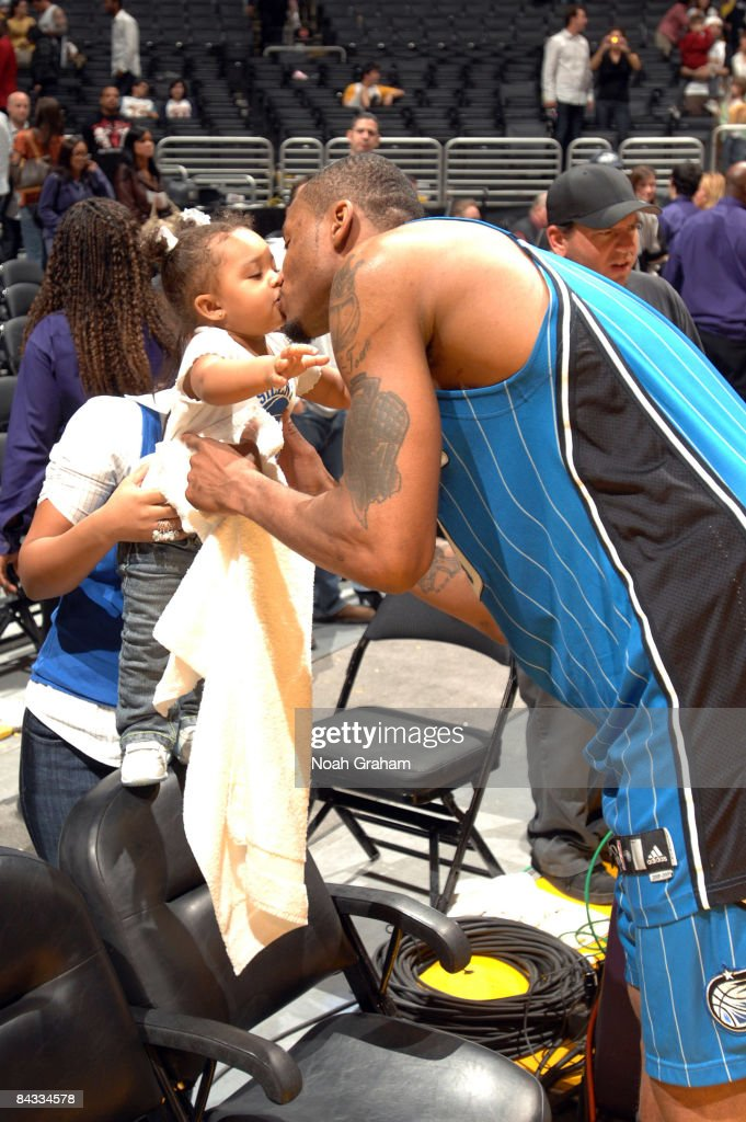 Rashard Lewis #9 of the Orlando Magic kisses his daughter Gianna following his team's victory over the Los Angeles Lakers at Staples Center on January 16, 2009 in Los Angeles, California. The Magic defeated the Lakers 109-103.
