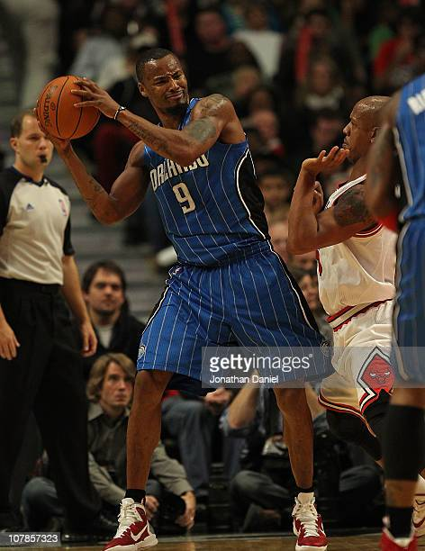 Rashard Lewis of the Orlando Magic looks to pass under pressure from Keith Bogans of the Chicago Bulls at the United Center on December 1 2010 in...