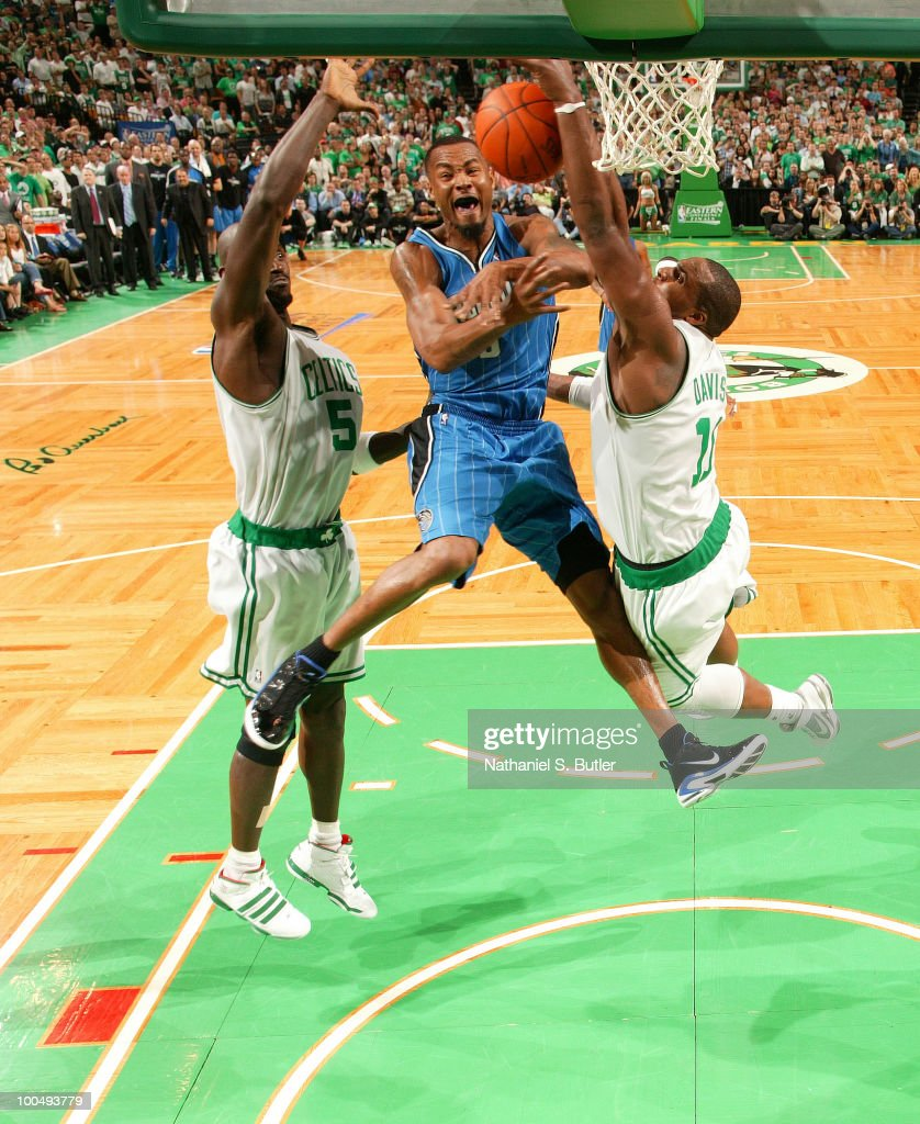 Rashard Lewis #9 of the Orlando Magic loses control of the ball and commits a turnover while defended by Kevin Garnett #5 and Glen Davis #11 of the Boston Celtics in Game Four of the Eastern Conference Finals during the 2010 NBA Playoffs on May 24, 2010 at the TD Garden in Boston, Massachusetts.