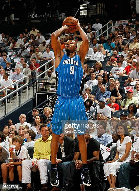 Rashard Lewis of the Orlando Magic shoots a wideopen threepoint basket against the Atlanta Hawks during Game Three of the Eastern Conference...