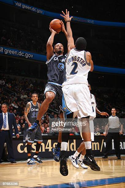 Rashard Lewis of the Orlando Magic shoots against Shaun Livingston of the Washington Wizards at the Verizon Center on March 13 2010 in Washington DC...