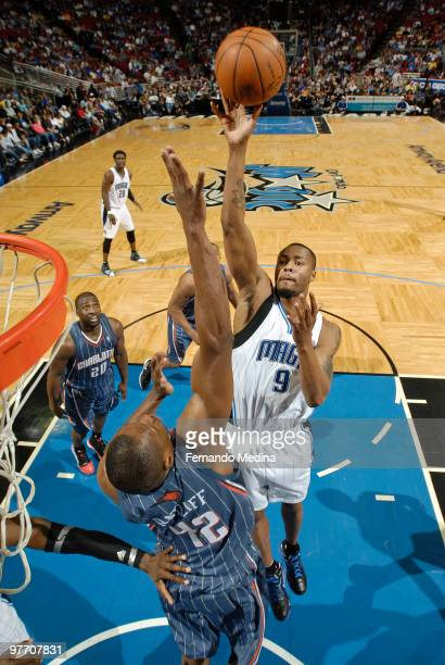 Rashard Lewis of the Orlando Magic shoots in the paint against Theo Ratliff of the Charlotte Bobcats during the game on March 14 2010 at Amway Arena...