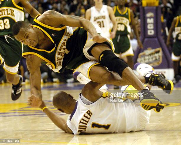 Rashard Lewis of the Seattle SuperSonics collides with Caron Butler of the Los Angeles Lakers during the game between the Seattle SuperSonics and the...