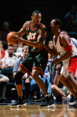 Rashard Lewis of the Seattle SuperSonics goes up against the Houston Rockets during the game on April 5 2001 at the Compaq Center in Houston Texas...