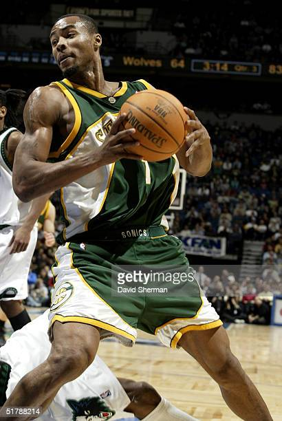 Rashard Lewis of the Seattle SuperSonics looks to make the pass in a game against the Minnesota Timberwolves on November 23 2004 at the Target Center...