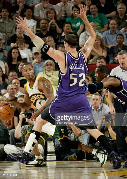 Rashard Lewis of the Seattle SuperSonics looks to pass against Brad Miller and Cuttino Mobley of the Sacramento Kings in Game two of the Western...