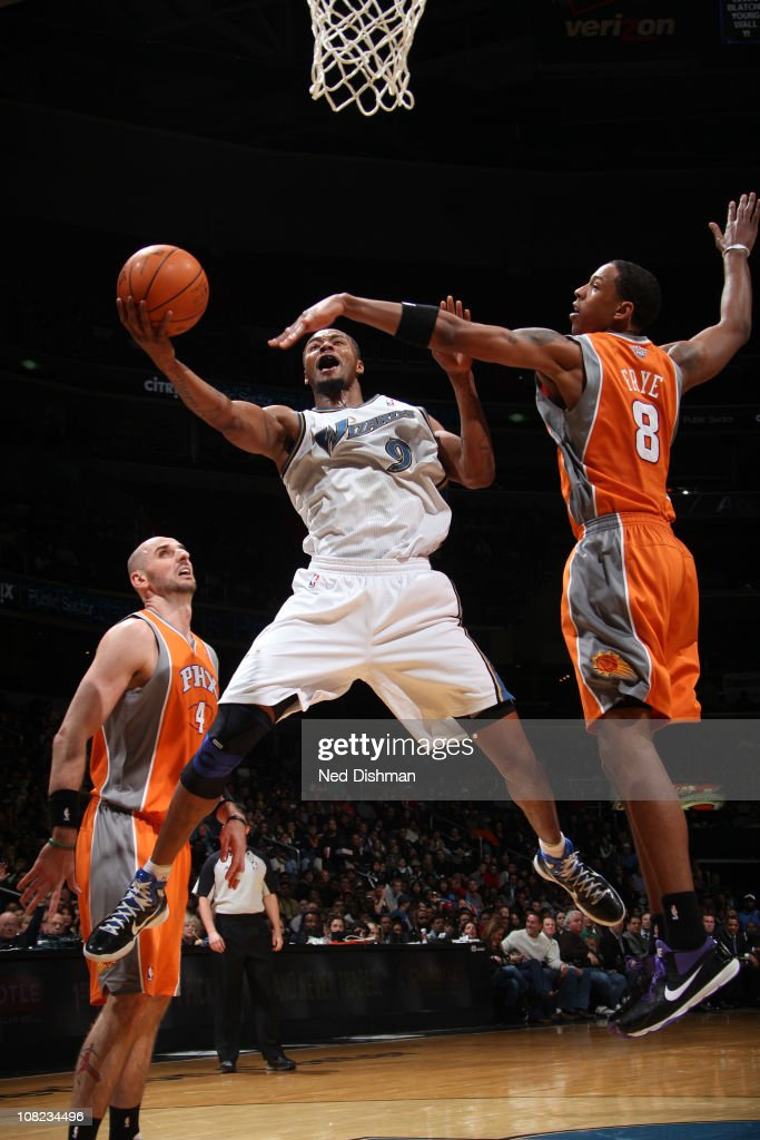 <a gi-track='captionPersonalityLinkClicked' href=/galleries/search?phrase=Rashard+Lewis&family=editorial&specificpeople=201713 ng-click='$event.stopPropagation()'>Rashard Lewis</a> #9 of the Washington Wizards shoots against <a gi-track='captionPersonalityLinkClicked' href=/galleries/search?phrase=Channing+Frye&family=editorial&specificpeople=206815 ng-click='$event.stopPropagation()'>Channing Frye</a> #8 and <a gi-track='captionPersonalityLinkClicked' href=/galleries/search?phrase=Marcin+Gortat&family=editorial&specificpeople=589986 ng-click='$event.stopPropagation()'>Marcin Gortat</a> #4 of the Phoenix Suns at the Verizon Center on January 21, 2011 in Washington, DC.