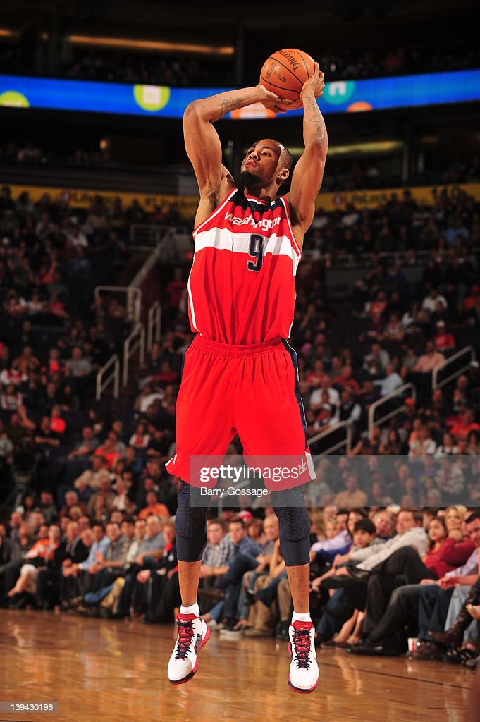 <a gi-track='captionPersonalityLinkClicked' href=/galleries/search?phrase=Rashard+Lewis&family=editorial&specificpeople=201713 ng-click='$event.stopPropagation()'>Rashard Lewis</a> #9 of the Washington Wizards shoots against the Phoenix Suns in an NBA game played on February 20, 2012 at U.S. Airways Center in Phoenix, Arizona.
