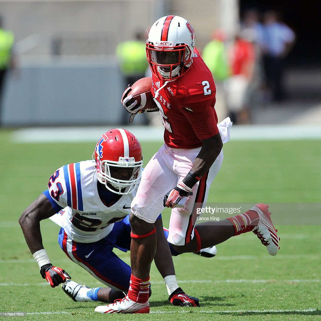 Rashard Smith #2 of the North Carolina State Wolfpack avoids a tackle by Kentrell Brice #23 of the Louisiana Tech Bulldogs at Carter-Finley Stadium on August 31, 2013 in Raleigh, North Carolina.