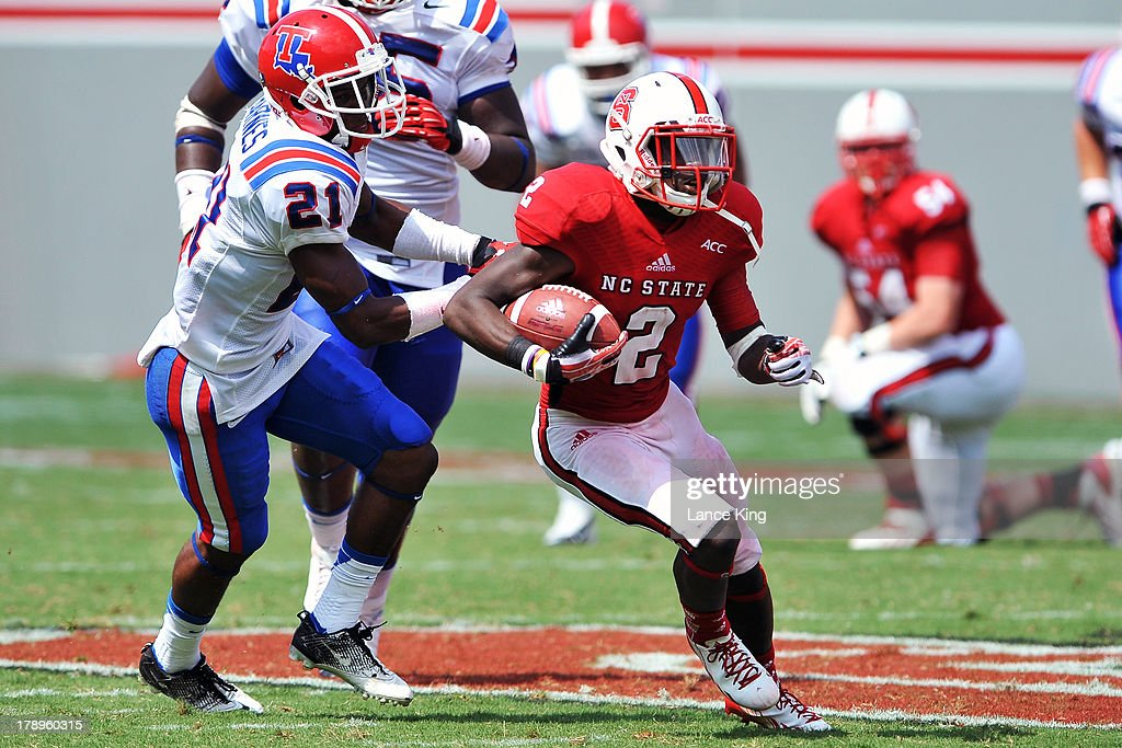 Rashard Smith #2 of the North Carolina State Wolfpack avoids a tackle by Adairius Barnes #21 of the Louisiana Tech Bulldogs at Carter-Finley Stadium on August 31, 2013 in Raleigh, North Carolina.