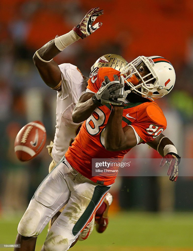 Rashawn Scott #80 of the Miami Hurricanes misses a pass defended by Xavier Rhodes #27 of the Florida State Seminoles during a game at Sun Life Stadium on October 20, 2012 in Miami Gardens, Florida.