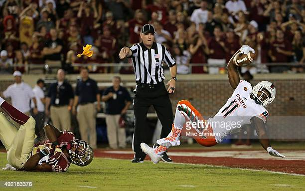 Rashawn Scott of the Miami Hurricanes scores a touchdown during a game against the Florida State Seminoles at Doak Campbell Stadium on October 10...