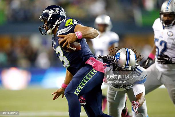 Rashean Mathis of the Detroit Lions attempts to tackle Russell Wilson of the Seattle Seahawks during the second half of their game at CenturyLink...