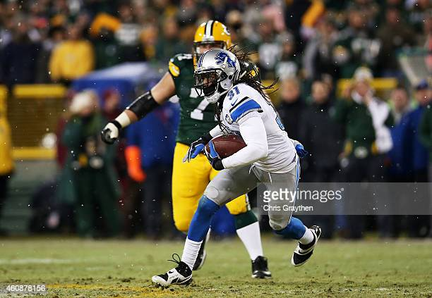 Rashean Mathis of the Detroit Lions carries a ball that was ruled down after a completion to Eddie Lacy of the Green Bay Packers in the third quarter...
