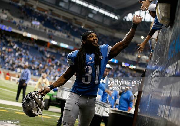 Rashean Mathis of the Detroit Lions celebrates with fans after a 2423 win over the New Orleans Saints at Ford Field on October 19 2014 in Detroit...