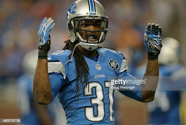Rashean Mathis of the Detroit Lions encourages the crown to make noise while playing the Denver Broncos at Ford Field on September 27 2014 in Detroit...