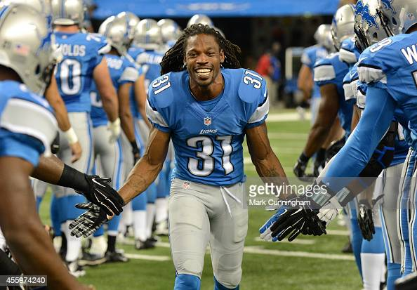 Rashean Mathis of the Detroit Lions gets handshakes from teammates during player introductions prior to the game against the Jacksonville Jaguars at...