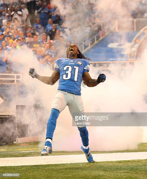 Rashean Mathis of the Detroit Lions runs onto the field during player introductions prior to the start of the game against the Green Bay Packers at...
