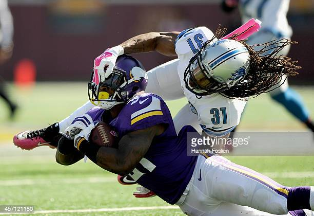Rashean Mathis of the Detroit Lions tackles Jerick McKinnon of the Minnesota Vikings during the second quarter of the game on October 12 2014 at TCF...