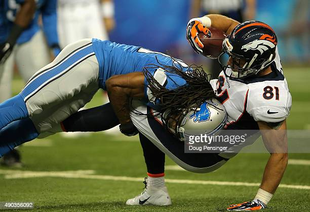 Rashean Mathis of the Detroit Lions tackles Owen Daniels of the Denver Broncos in the first quarter at Ford Field on September 27 2014 in Detroit...