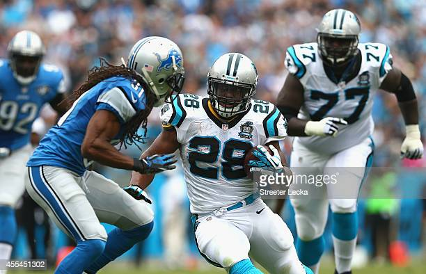 Rashean Mathis of the Detroit Lions tries to stop Jonathan Stewart of the Carolina Panthers in the second half during the game at Bank of America...