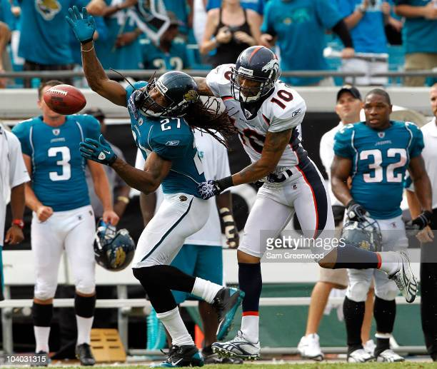Rashean Mathis of the Jacksonville Jaguars attempts to make an interception against Jabar Gaffney of the Denver Broncos during the NFL season opener...