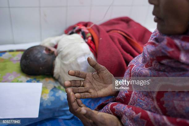 Rasheda mother of Rakib prays to God for his life Rakib 11 a child labour one of the victims of petrol bomb attack on a bus cries in pain as he...