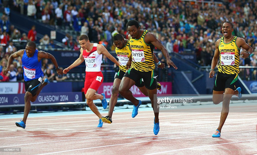 <a gi-track='captionPersonalityLinkClicked' href=/galleries/search?phrase=Rasheed+Dwyer&family=editorial&specificpeople=7243414 ng-click='$event.stopPropagation()'>Rasheed Dwyer</a> of Jamaica (2R) crosses the line to win gold ahead of in bronze medalist <a gi-track='captionPersonalityLinkClicked' href=/galleries/search?phrase=Jason+Livermore&family=editorial&specificpeople=7165850 ng-click='$event.stopPropagation()'>Jason Livermore</a> of Jamaica (C), silver medalist <a gi-track='captionPersonalityLinkClicked' href=/galleries/search?phrase=Warren+Weir&family=editorial&specificpeople=9482526 ng-click='$event.stopPropagation()'>Warren Weir</a> of Jamaica (R), Mosito Lehata of Lesotho (L) and Danny Talbot of England (2L) in the Men's 200 metres Final at Hampden Park during day eight of the Glasgow 2014 Commonwealth Games on July 31, 2014 in Glasgow, United Kingdom.