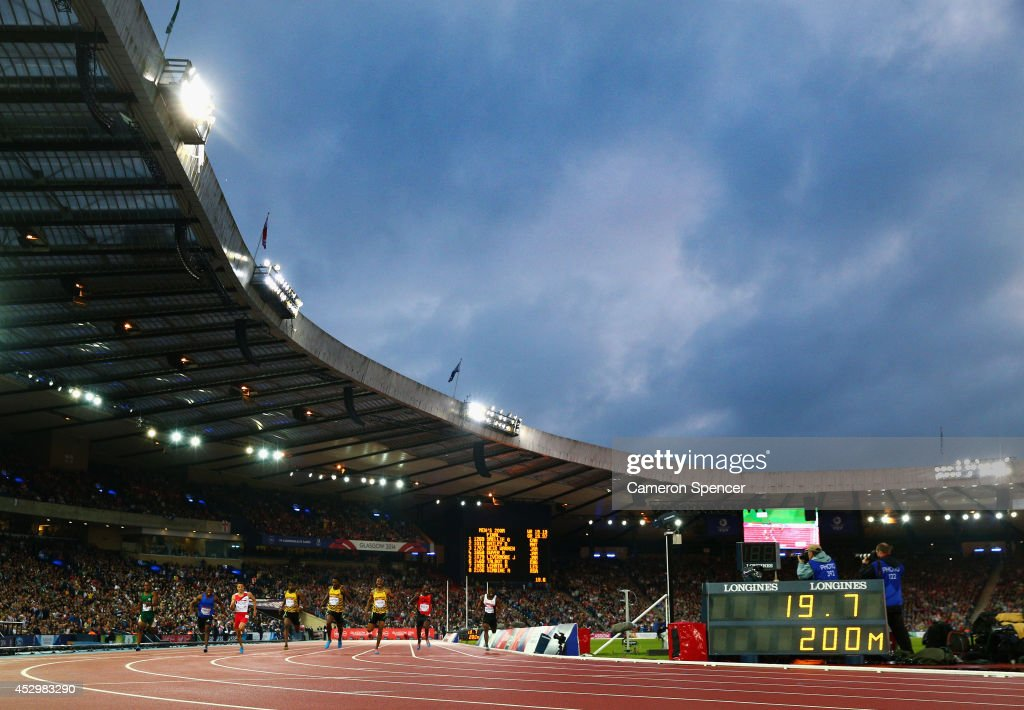 <a gi-track='captionPersonalityLinkClicked' href=/galleries/search?phrase=Rasheed+Dwyer&family=editorial&specificpeople=7243414 ng-click='$event.stopPropagation()'>Rasheed Dwyer</a> of Jamaica crosses the line to win gold ahead of silver medalist <a gi-track='captionPersonalityLinkClicked' href=/galleries/search?phrase=Warren+Weir&family=editorial&specificpeople=9482526 ng-click='$event.stopPropagation()'>Warren Weir</a> of Jamaica and bronze medalist <a gi-track='captionPersonalityLinkClicked' href=/galleries/search?phrase=Jason+Livermore&family=editorial&specificpeople=7165850 ng-click='$event.stopPropagation()'>Jason Livermore</a> of Jamaica in the Men's 200 metres Final at Hampden Park during day eight of the Glasgow 2014 Commonwealth Games on July 31, 2014 in Glasgow, United Kingdom.