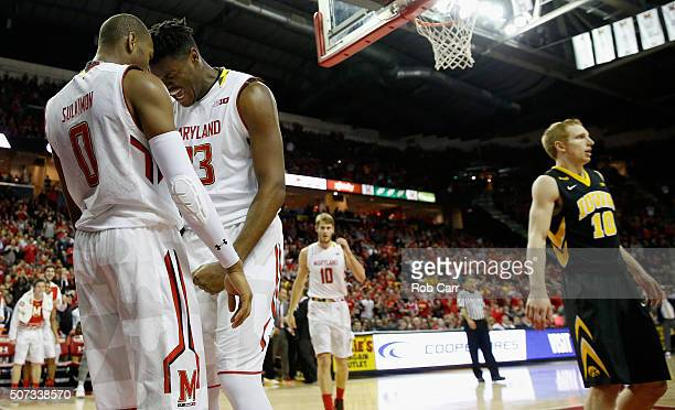 Rasheed Sulaimon and Diamond Stone of the Maryland Terrapins celebrate after Stone scored a basket and was fouled against the Iowa Hawkeyes in the...