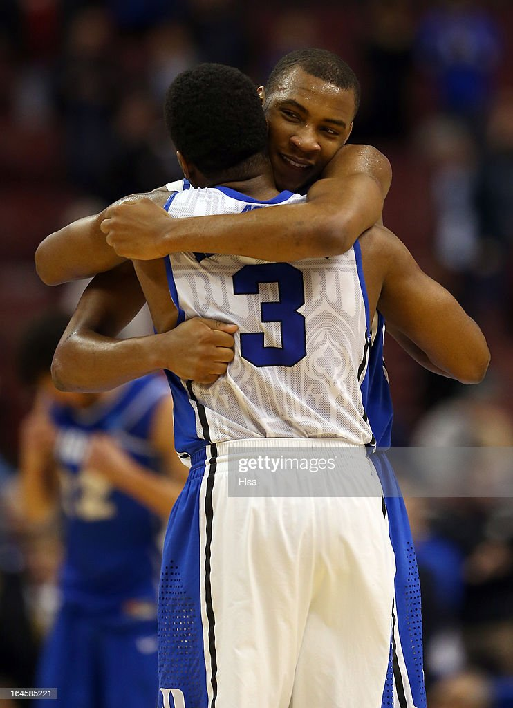 Rasheed Sulaimon #14 hugs Tyler Thornton #3 of the Duke Blue Devils after the Blue Devils defeat the Creighton Bluejays 66-50 during the third round of the 2013 NCAA Men's Basketball Tournament at Wells Fargo Center on March 24, 2013 in Philadelphia, Pennsylvania.