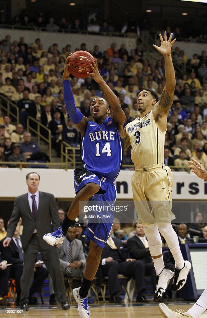 <a gi-track='captionPersonalityLinkClicked' href=/galleries/search?phrase=Rasheed+Sulaimon&family=editorial&specificpeople=7887134 ng-click='$event.stopPropagation()'>Rasheed Sulaimon</a> #14 of the Duke Blue Devils attempts a layup against Cameron Wright #3 of the Pittsburgh Panthers at Petersen Events Center on January 27, 2014 in Pittsburgh, Pennsylvania.